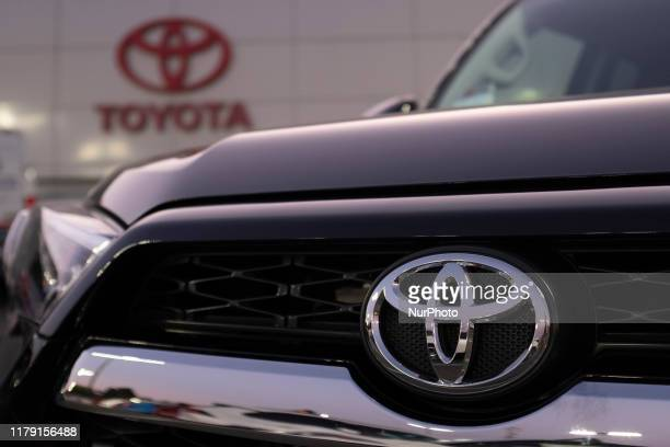Toyota logo is seen on a Toyota 4Runner at its dealership in San Jose, California on August 27, 2019. United States and Japan has reached a...