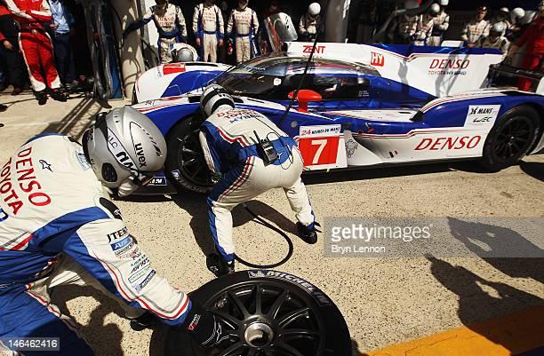 Toyota mechanics perform a pit stop during Le Mans 24 Hour race at the Circuit de la Sarthe on June 16 2012 in Le Mans France