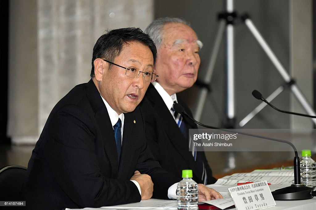 Toyota Motor Co President Akio Toyoda (L) speaks while Suzuki Motor Co Chairman Osamu Suzuki (R) listens during a joint press conference at the Toyota's Tokyo headquarters on October 12, 2016 in Tokyo, Japan. Automakers are in discussion on business partnership in the environment, safety, and information technology fields.