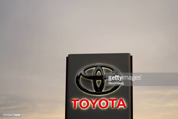 Toyota Motor Co. Signage is displayed outside a dealership at dusk in Tokyo, Japan, on Sunday, May 10, 2020. Globalautomakersand suppliers are on...
