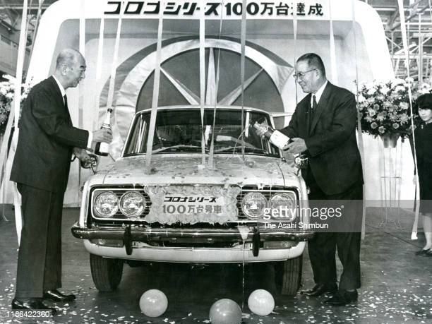 Toyota Motor Co Vice President Taiichi Ohno and Toyota Sales Vice President Shiro Onishi pour Champagne on the 100 millionth Corona during the line...