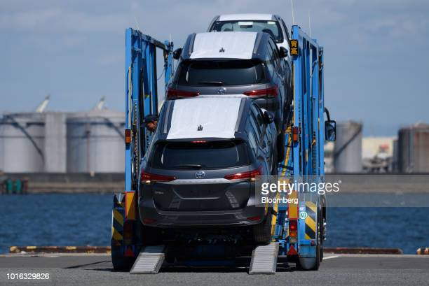 Toyota Motor Cop vehicles are unloaded from a car carrier trailer at the Nagoya Port in Nagoya Japan on Tuesday July 31 2018 Japan is scheduled to...
