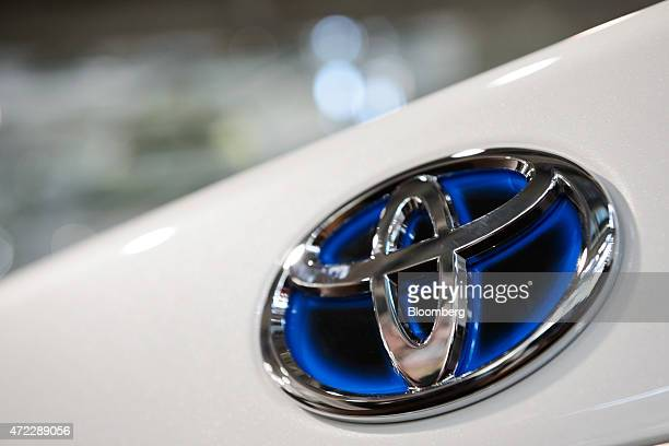 A Toyota Motor Corp badge is displayed on a Crown Majesta sedan at the company's Mega Web showroom in Tokyo Japan on Tuesday May 5 2015 Toyota Motor...
