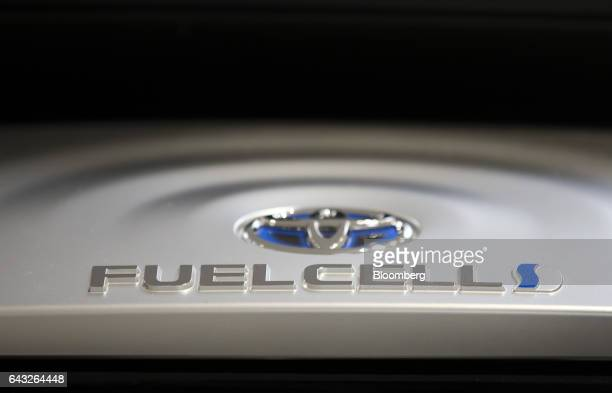 A Toyota Motor Corp badge is displayed on the engine of Mirai fuelcell vehicle in the showroom of the company's headquarters in Toyota City Aichi...