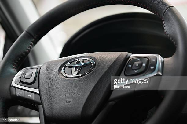 A Toyota Motor Corp badge is displayed on the steering wheel of a vehicle at the company's Mega Web showroom in Tokyo Japan on Tuesday May 5 2015...