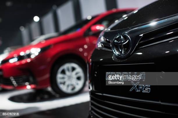 Toyota Motor Corp. Badge is seen on the new2018 Toyota Corolla vehicle as it sits on display during the company's launch event in Sao Paulo, Brazil,...