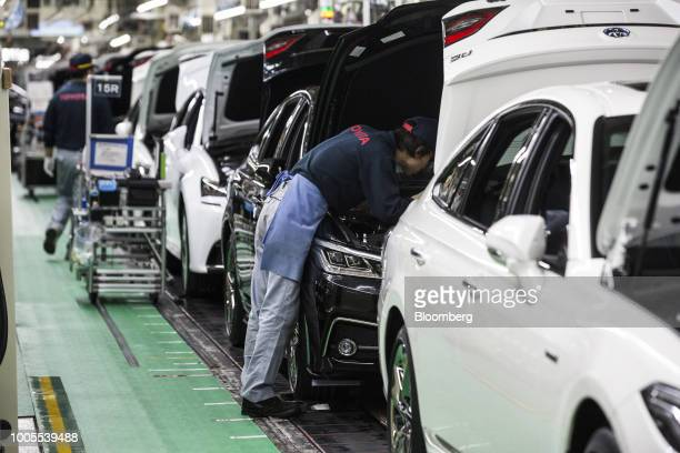 Toyota Motor Corp. Employee assembles a Crown vehicle on the production line at the company's Motomachi plant in Toyota City, Aichi, Japan, on...