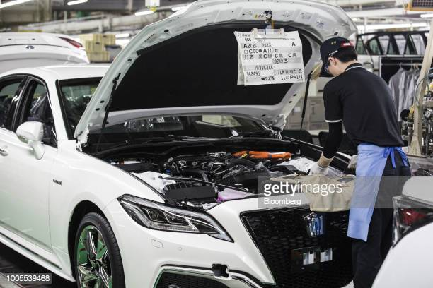 Toyota Motor Corp. Employee works while assembling a Crown vehicle on the production line at the company's Motomachi plant in Toyota City, Aichi,...