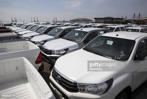 Toyota Motor Corp Hilux pickup trucks bound for shipment sit parked in a lot at the Nagoya Port in Nagoya Japan on Saturday March 18 2017 Japan is...