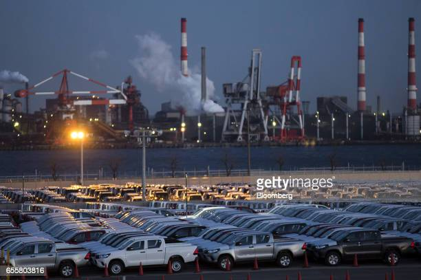 Toyota Motor Corp Hilux pickup trucks bound for shipment sit parked in a lot at night at the Nagoya Port in Nagoya Japan on Friday March 17 2017...