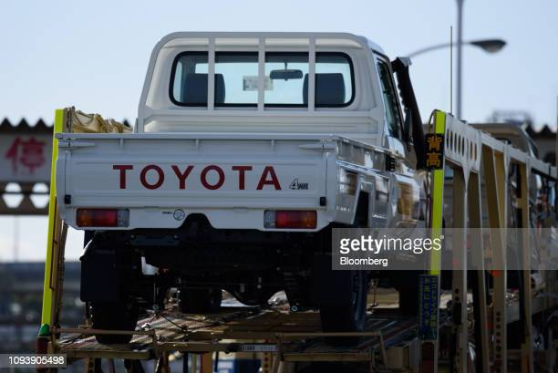 Toyota Motor Corp Land Cruiser pickup trucks are transported on a car carrier trailer at the Nagoya Port in Tokai Aichi Prefecture Japan on Friday...