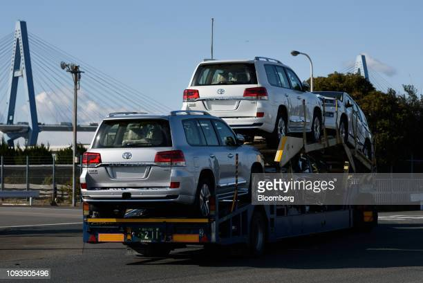 Toyota Motor Corp Land Cruiser sport utility vehicles are transported on a car carrier trailer at the Nagoya Port in Tokai Aichi Prefecture Japan on...