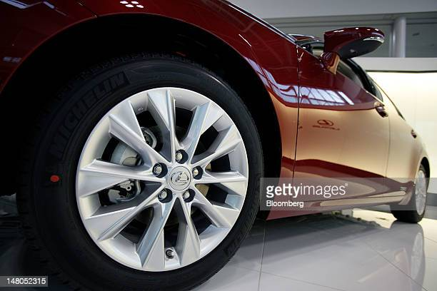 A Toyota Motor Corp Lexus ES300h sedan is displayed in the visitor's center at Toyota Motor Kyushu Inc's Miyata plant in Miyawaka City Fukuoka...