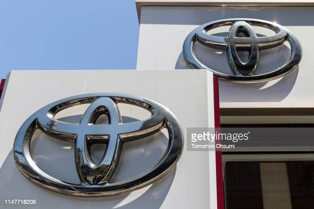 Toyota Motor Corp. Logos are displayed outside one of the company's dealerships on May 8, 2019 in Tokyo, Japan. Toyota announced its financial...