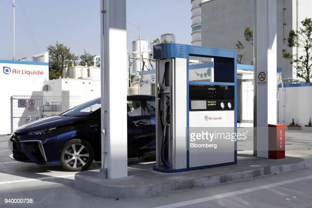 A Toyota Motor Corp Mirai fuelcell vehicle sits parked next to a hydrogen pump at the Kawasaki Hydrogen Station operated by Air Liquide Japan Ltd in...