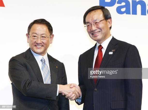 Toyota Motor Corp President Akio Toyoda and Panasonic Corp CEO Kazuhiro Tsuga shake hands at a joint press conference in Tokyo on Dec 13 2017 The two...