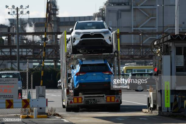 Toyota Motor Corp Rav4 sport utility vehicles are transported on a car carrier trailer at the Nagoya Port in Tokai Aichi Prefecture Japan on Friday...