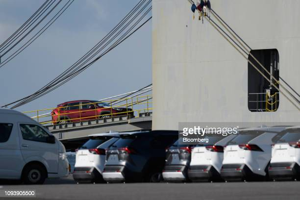 A Toyota Motor Corp Rav4 sport utility vehicles is driven onto a vehicle transporter ship at the Nagoya Port in Tokai Aichi Prefecture Japan on...