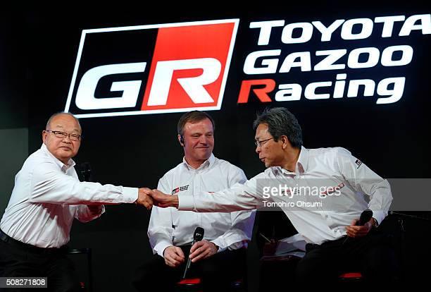 Toyota Motor Corp Senior Managing Officer Koei Saga left shakes hands with Toyota Motorsport GmbH President Toshio Sato right as Tommi Makinen head...