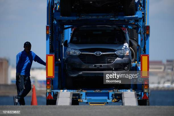 A Toyota Motor Corp vehicle sits in a car carrier trailer at the Nagoya Port in Nagoya Japan on Tuesday July 31 2018 Japan is scheduled to release...