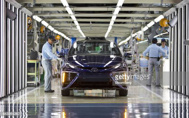 Toyota Motor Corp. Worker inspects a Mirai fuel-cell vehicle on the production line of the company's Motomachi plant in Toyota City, Aichi, Japan, on...