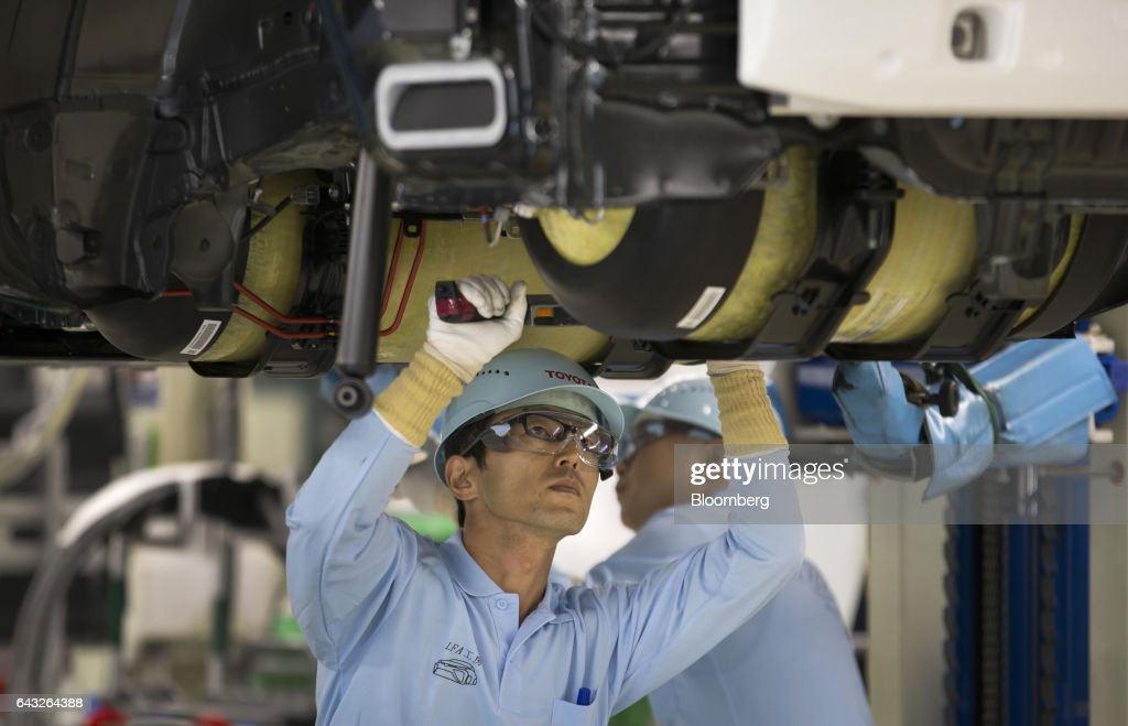 Toyota Motor Corp  workers install hydrogen tanks in a Mirai