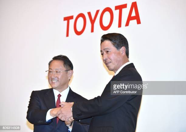 Toyota Motor Corporation President Akio Toyoda and Mazda Motor Corporation President and CEO Masamichi Kogai shake hands after their joint press...