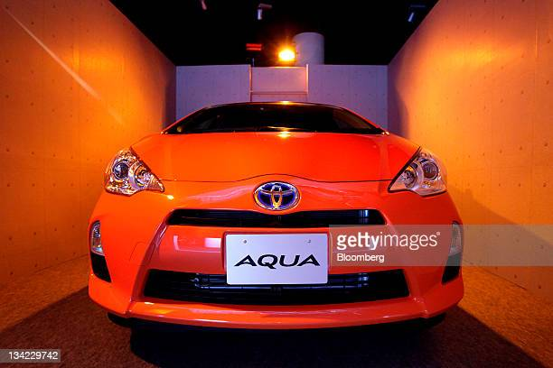 Toyota Motor Corp's Aqua hybrid vehicle sits on display during a preview event ahead of the Tokyo Motor Show 2011 in Tokyo Japan on Monday Nov 28...