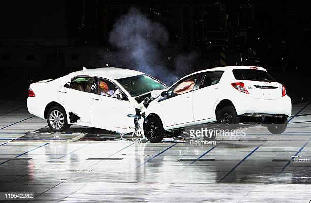 Toyota Motor Corp's Crown left and Vitz vehicles collide during a crash test at the company's Higashifuji Technical Center in Susono city Shizuoka...