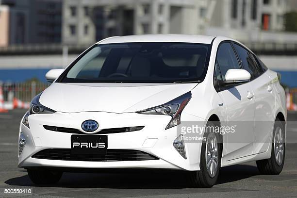 Toyota Motor Corp's fourthgeneration Prius hybrid vehicle stands on display in Tokyo Japan Wednesday Dec 9 2015 The automaker said it aimed to sell...