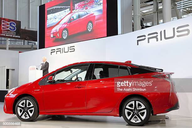 Toyota Motor Co's Executive Vice President Mitsuhisa Kato addresses at the sales launch of the fourth generation Prius on December 9 2015 in Tokyo...