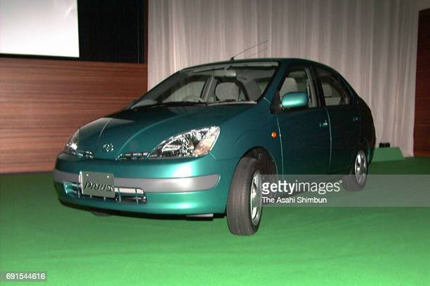 Toyota Motor Co's new hybrid Vehicle 'Prius' is is displayed during the unveiling press conference on October 14 1997 in Nagoya Aichi Japan