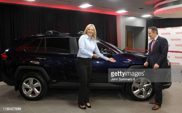 Toyota Motor Manufacturing Kentucky President Susan Elkington and Kentucky Governor Matt Bevin show off the 2019 Toyota RAV4 Hybrid at the Toyota...