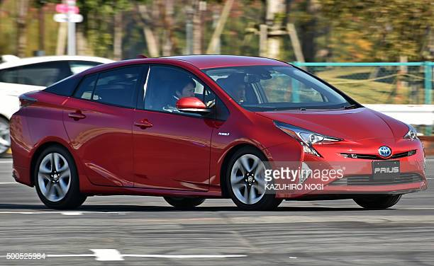 Toyota Motor's new Prius is driven at test drive event in Tokyo on December 9 2015 Toyota's fourthgeneration Prius launched at dealers across Japan...