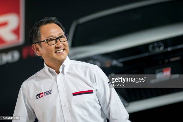 Toyota Motors president Akio Toyoda poses beside a GR86 vehicle during a press preview for the company's line of tuned road cars under the GAZOO...