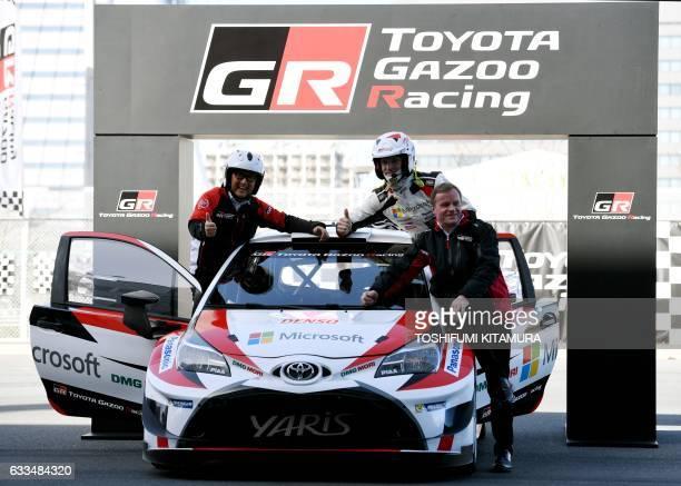 Toyota Motors president Akio Toyoda poses with Toyota Gazoo Racing WRC team driver JariMatti Latvala of Finland and team principal Tommi Makinen...