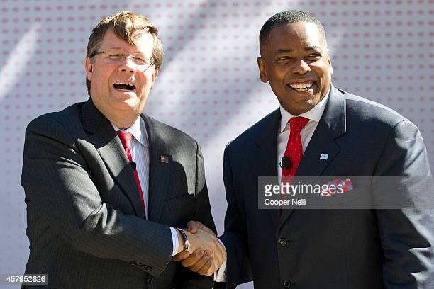 Toyota North America CEO Jim Lentz shakes hands with Plano Mayor Harry LaRosiliere as Toyota announces the donation of six Texas built Toyota Tundra...