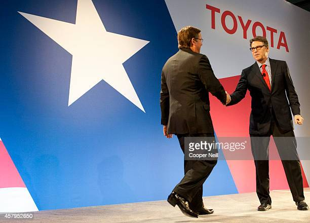 Toyota North America CEO Jim Lentz shakes hands with Texas Governor Rick Perry during the Toyota 'Hello Texas' event on October 27 2014 in Plano Texas