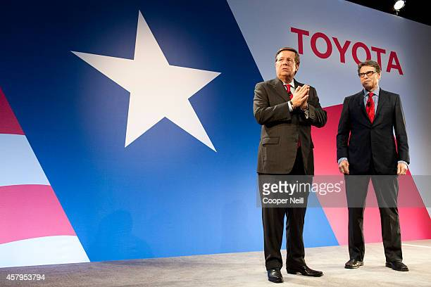 Toyota North America CEO Jim Lentz speaks with Texas Gov Rick Perry during the Toyota 'Hello Texas' event on October 27 2014 in Plano Texas