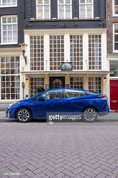 Toyota Prius bright blue plug-in hybrid car parked on the street in Amsterdam