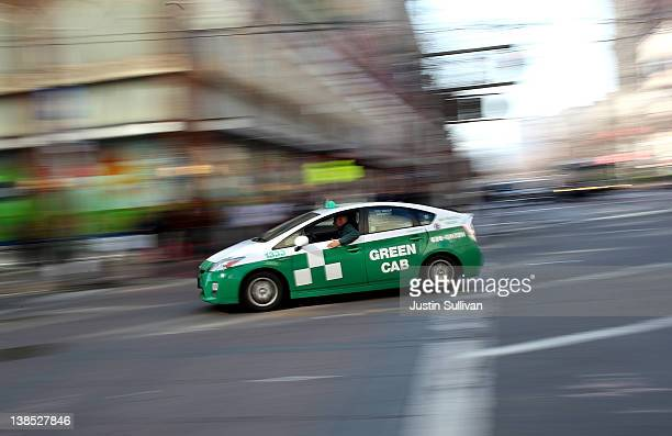 Toyota Prius hybrid taxi cab drives across Market Street on February 8 2012 in San Francisco California San Francisco city officials announced today...