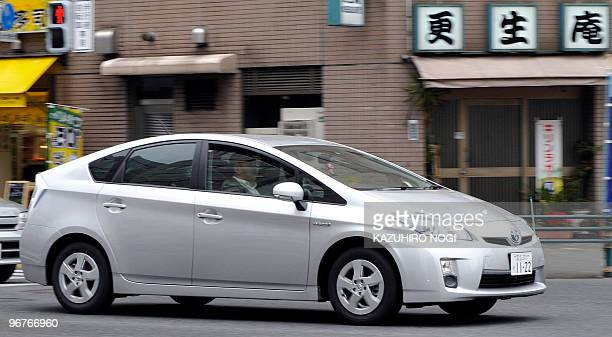 A Toyota Prius hybrid vehicle drives down a street in Tokyo on February 17 2010 Toyota Motor Corp President Akio Toyoda will hold a news conference...