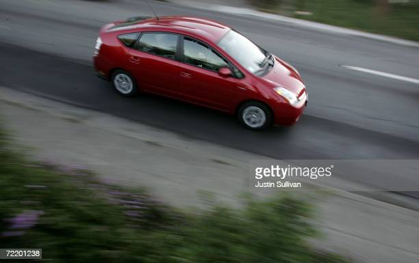 Toyota Prius hybrid vehicle is seen driving down the street October 17 2006 in San Anselmo California Economy and Hybrid vehicles built by Toyota and...
