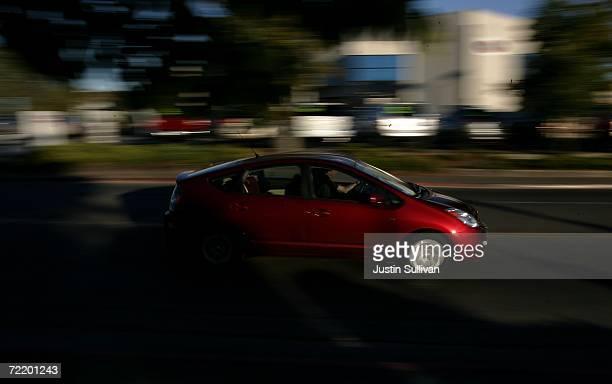Toyota Prius hybrid vehicle is seen driving down the street October 17 2006 in San Rafael California Economy and Hybrid vehicles built by Toyota and...