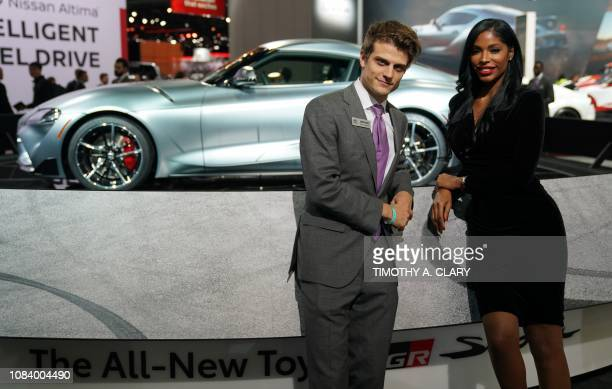 Toyota product specialist Emerson Niemchick and Priscilla Tejeda pose at the 2019 North American International Auto Show January 15 2019 at the Cobo...