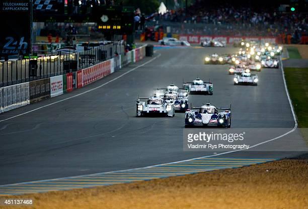 Toyota Racing of Alex Wurz Stephane Sarrazin and Kazuki Nakajima leads after the start ahead of Porsche 919 Hybrid Porsche Team Romain Dumas Neel...