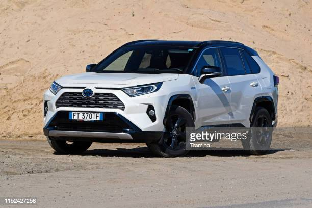 toyota rav4 hybrid on the road - hybrid vehicle stock pictures, royalty-free photos & images