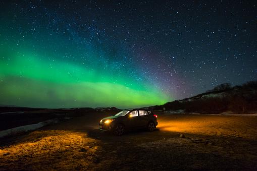 Toyota RAV4 with Aurora borealis (Northern lights) - gettyimageskorea
