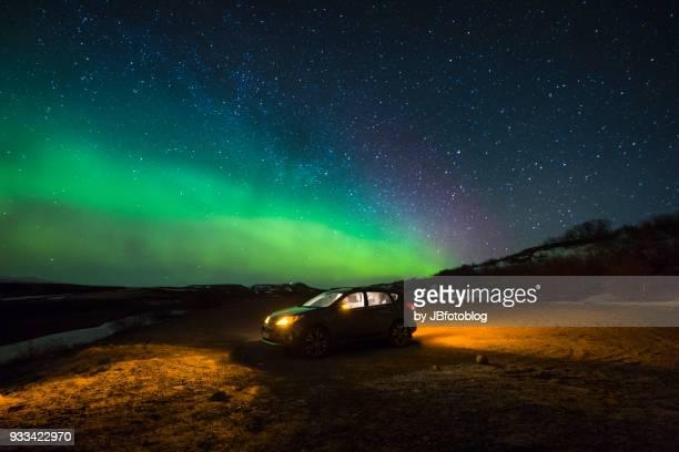 toyota rav4 with aurora borealis (northern lights) - aurora illinois stock photos and pictures