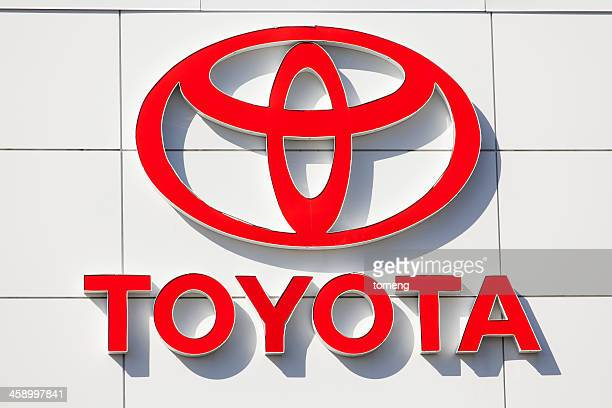 toyota sign at car dealership - toyota motor co stock pictures, royalty-free photos & images